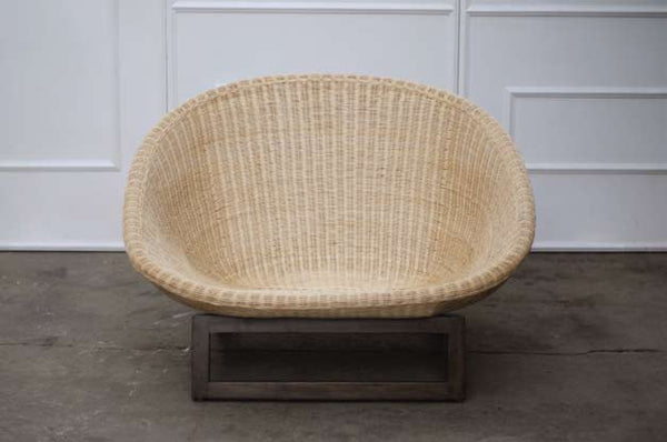 NZ indoor or outdoor Camburi natural rattan chair woven over steel frame on solid teak base