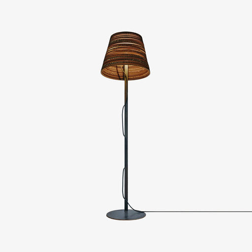 designer floor lamp with tilted shade made from sustainable recycled cardboard