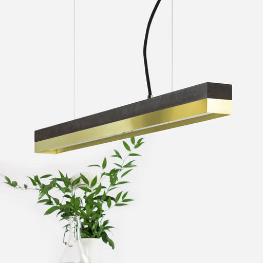 dark grey concrete and brass rectangular pendant light