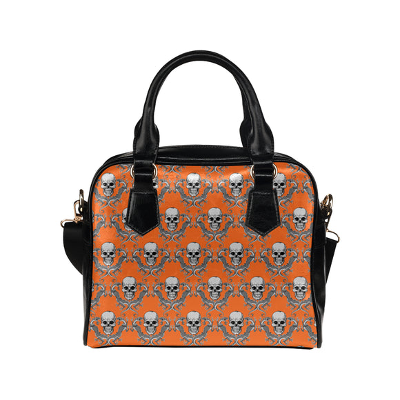 Sac à main en cuir au design têtes de mort et dragons orange