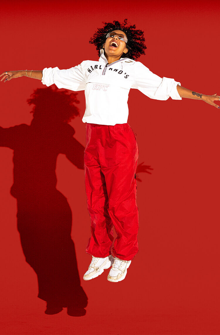 girl_jumping_KFC_windbreaker