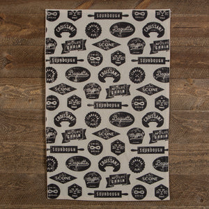 100% cotton black and cream tea towel with bakery-inspired print.