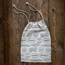 Black and cream cotton bread bag with bakery-inspired print.