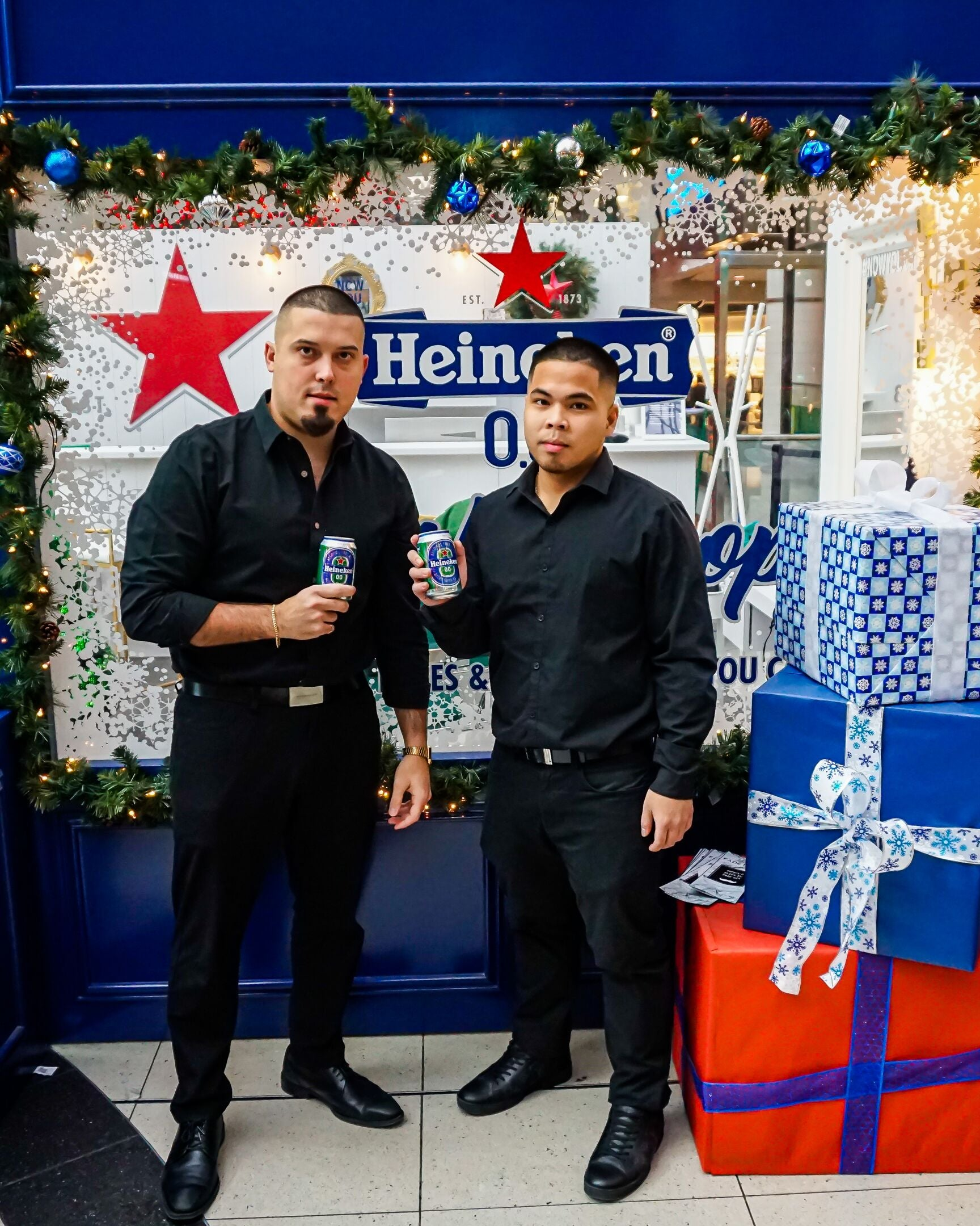 Heineken 0.0 Christmas Holiday Pop-up at Eaton Centre Toronto with Fade Room barbershop. Claudio Ferreira (left), Emmanuel Andrei Climaco (right)