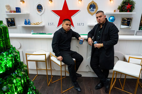 Claudio Ferreira and Emmanuel Andrei Climaco at the Fade Room Heineken barbershop event at Toronto's Eaton Centre