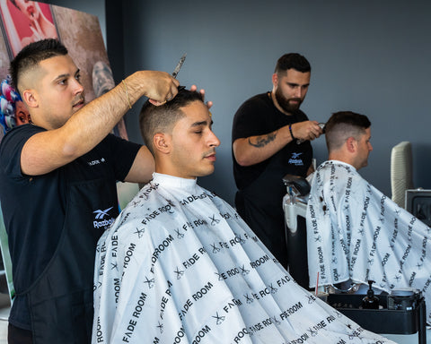 Claudio Ferreira and Joshua Dos Santos cut hair at Reebok. Fades from Fade Room barbershop