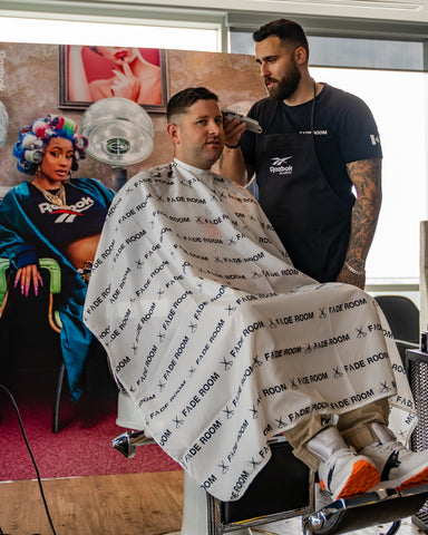 Joshua Dos Santos, Fade Room barber at the Reebok event Reebok barbershop