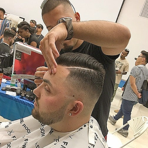 Claudio Ferreira at barber battle - comb over haircut category