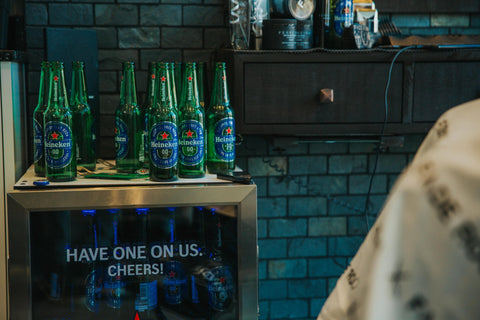 Have one on us. Cheer's Fade Room and Heineken's partnership