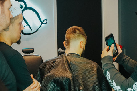 Scott Ramos and Claudio Ferreira look and learn barber class
