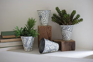 SET OF FOUR PRESSED METAL FLOWER BUCKETS