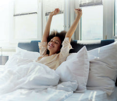 Woman waking up refreshed