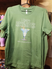 Mixed drinks about feelings shirt on display in gift shop