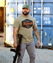 Patriotic Second Amendment tee on model holding gun