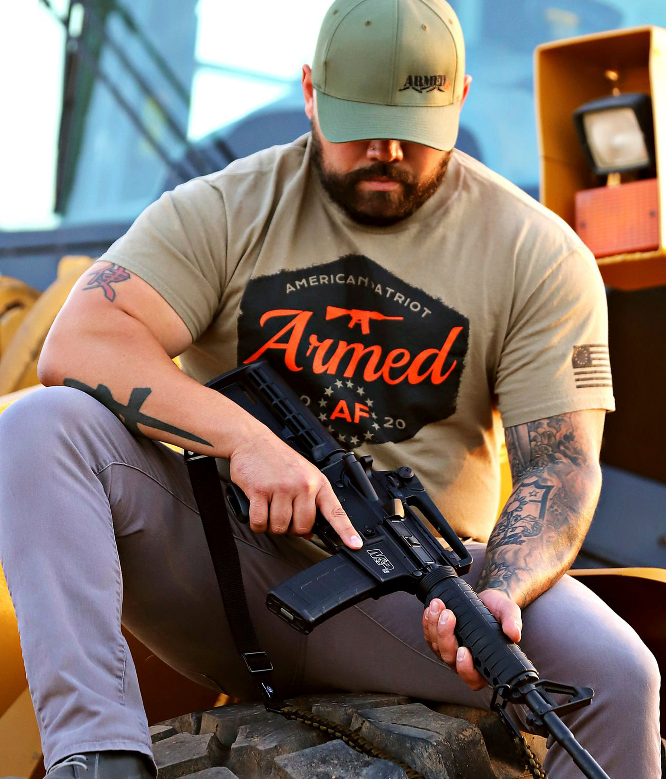 Armed AF t-shirt on man with hat