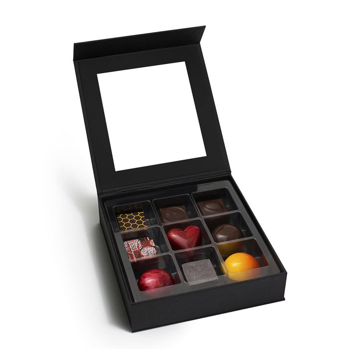 An assortment of milk and dark chocolate truffles showcasing Feve's top flavors.  A luxury chocolate collection like no other.  Makes a great holiday gift, business gift, or client gift.  Locally made in San Francisco with natural ingredients and sustainable, fair-trade chocolate.