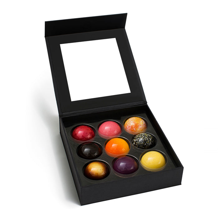 Feve's colorful box of dome-shaped chocolate truffles, with popular and seasonal milk and dark chocolate flavors.  This premium chocolate collection comes in a luxury box and makes a great holiday gift, corporate gift, or employee appreciation gift.  Handmade in San Francisco from sustainable, fair-trade chocolate.