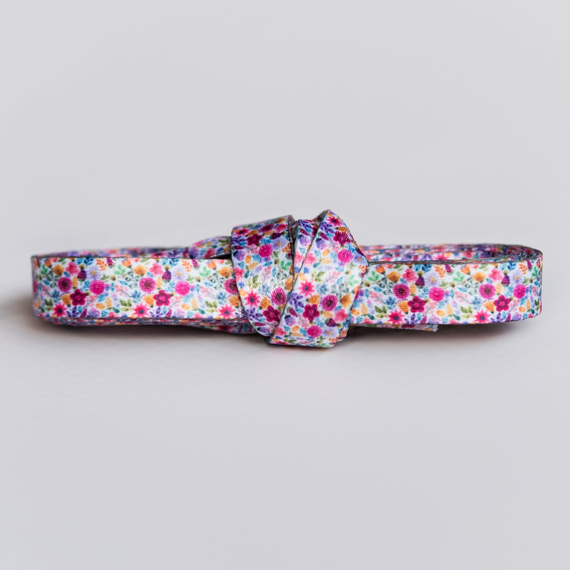 Floral shoelaces with purple, yellow, pink and blue flowers
