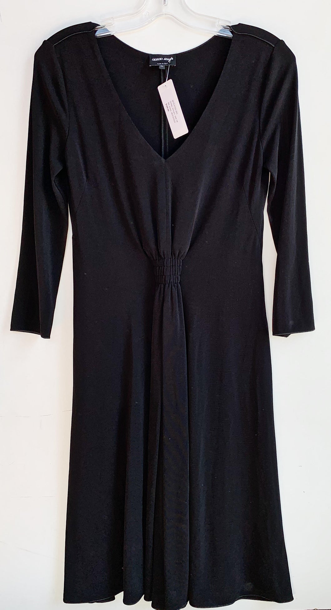 This flattering black Armani dress is perfect for a night out on the town. Made of 95% Viscose and 5 % Elastane. Size S, new condition. Available at Victoria Park.