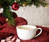 This delicious eggnog cocktail in a crushed candy cane-rimmed mug is made with HDC Vanilla Vodka and can be served hot or cold.