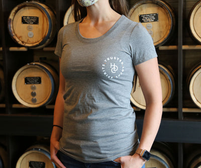 "A light grey tshirt with the HDC logo and ""trusted local spirits"" (in white lettering)."