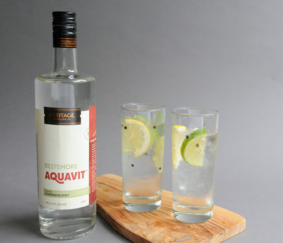 A 750ml bottle of HDC Bestemors Aquavit and two tall cocktails.