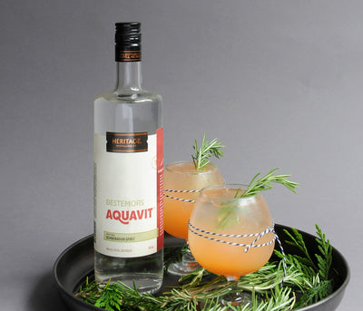 A 750ml bottle of HDC Bestemors Aquavit and two cocktails.