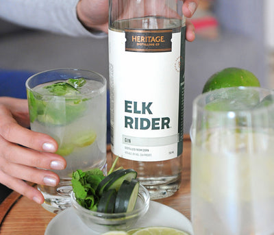 A 750ml bottle of HDC Elk Rider Gin and a gin and tonic cocktail.