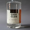 A 750ml bottle of HDC Cask Club Unaged Bourbon (clear liquid).