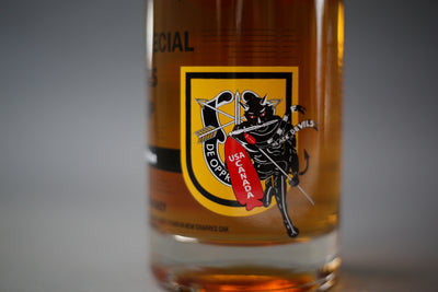 A zoomed in photo of a 750ml bottle of 1st Special Forces Group Whiskey - 6th Edition - 2020 Release.