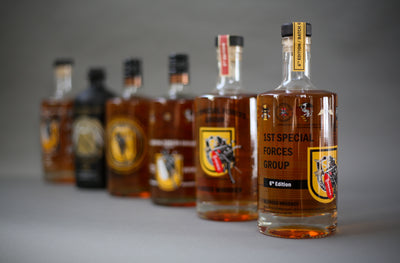 A photograph of the 6 different editions of the Special Forces Whiskey (but only the 6th Edition is being sold on here).