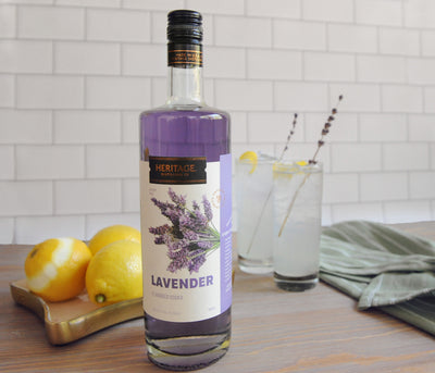 A 750ml bottle of HDC Lavender Vodka and a Lavender Lemonade cocktail.