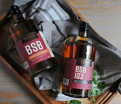 A bottle of A 750ml bottle of HDC BSB® - Brown Sugar Bourbon and a 750ml bottle of HDC BSB 103® - Limited Supplies Available.