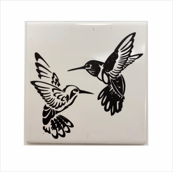 Hummingbirds dance in flight ceramic coaster