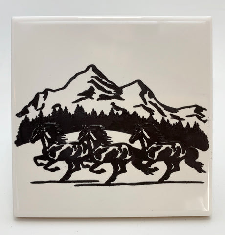 Herd of horses running ceramic coaster