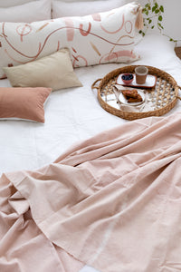 BOTANICALLY-DYED CUSHIONS AND BLANKETS