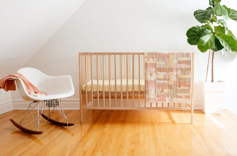 nursery with rocking chair and crib