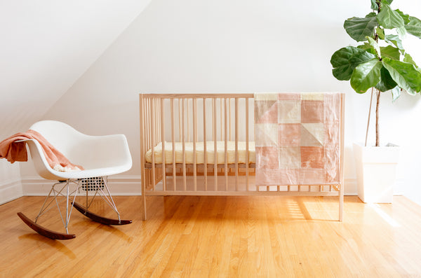 nursery with crib and fiddle leaf fig tree