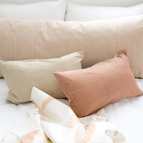 lumbar throw pillows in sage and clay colours