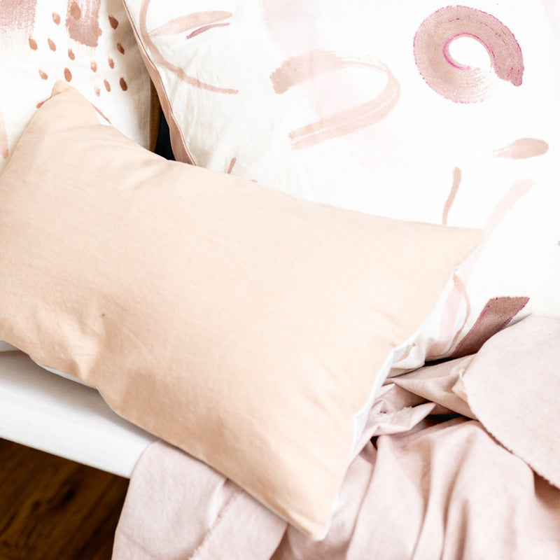 light pink lumbar pillow