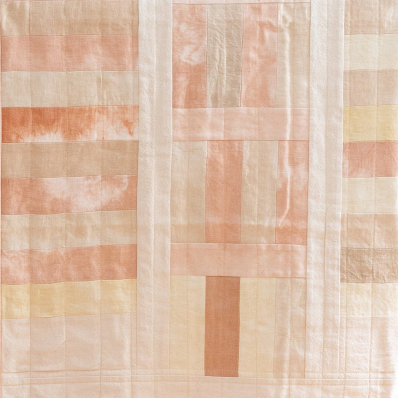 baby quilt with pink, tan and yellow rectangles