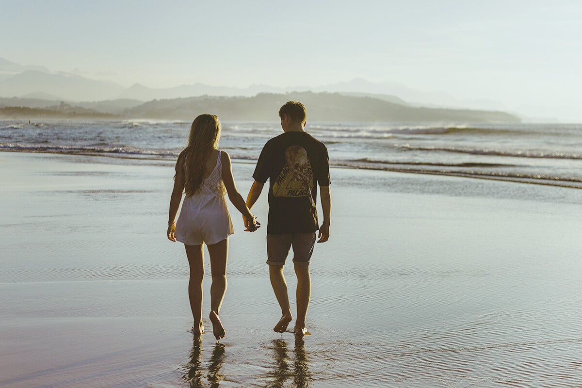 Couple Walk on the Beach - How To Naturally De-Stress