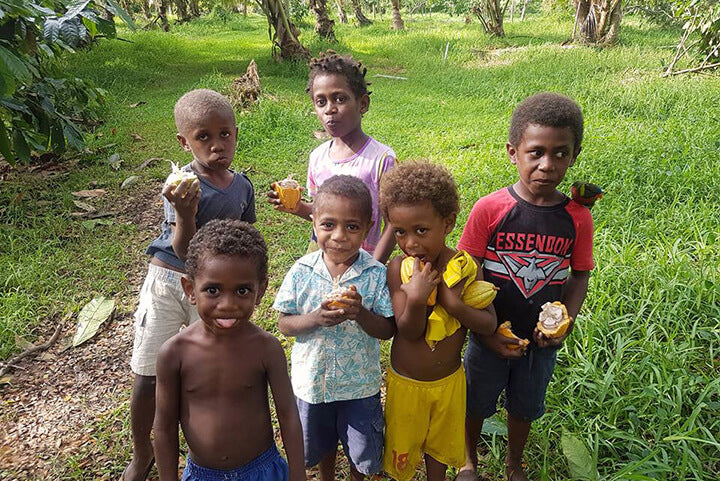 Ni-Vanuatu children with their raw Cacao - Tamanu Australia