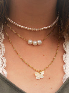 Layered chain choker with pearls and shell butterfly