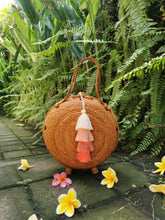 This rattan bag is hand woven in Bali, no two rattan bags are identical, there can be slight differences in the size and coloring of each purse.