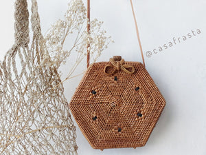 Pinterest rattan street level bags star accessories pompom tassels rattan backpack Bali Store Brown white shell school western rattan straw bags