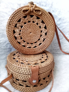 This large rattan bag is beautiful and holds quite a bit for a small bag, get ready to fall in love with the interior color. The closure is very secure.