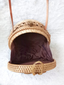 You will absolutely adore this round rattan crossbody bag, surprise batik pattern lining, super fashionable & lightweight. Perfect for all weather.