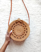 Beautiful round rattan bag!! It's well made from the natural straw purse and very sturdy.