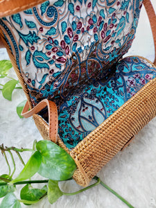 This rattan envelope bag is unique, adorable and well made. you will love the batik fabric lining the inside handwoven by pure Balinese artisans.
